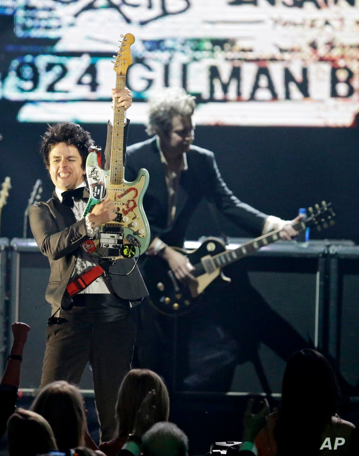 Billie Joe Armstrong, front, and Mike Dirnt, from Green Day perform at the Rock and Roll Hall of Fame Induction Ceremony in Cleveland, Ohio, April 18, 2015.