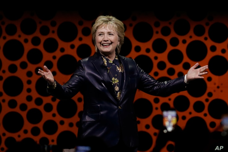 Former Secretary of State Hillary Clinton gestures while speaking before the Professional Businesswomen of California, March 28, 2017, in San Francisco.