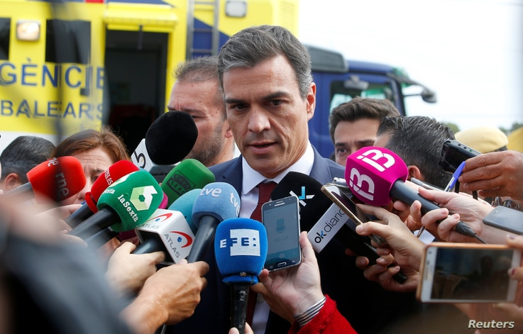 Spain's Prime Minister Pedro Sanchez speaks to media as heavy rain and flash floods hit Sant Llorenc de Cardassar on the island of Mallorca, Oct. 10, 2018.