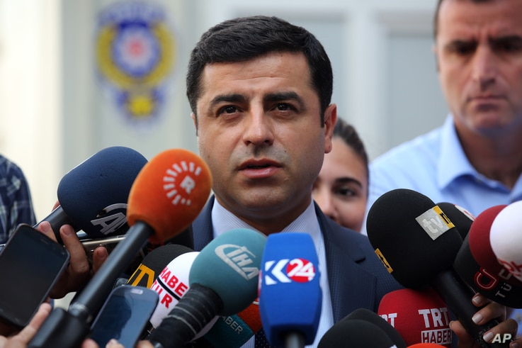 FILE - Pro-Kurdish Peoples' Democracy Party leader Selahattin Demirtas speaks to the media about Turkey's airstrikes against Kurdish rebel bases in Iraq, in Ankara, Turkey, July 27, 2015.