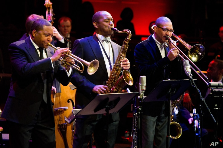FILE - Musicians Wynton Marsalis, left, Branford Marsalis, center, and Delfeayo Marsalis perform at the National Endowment for the Arts Jazz Master Awards Ceremony and Concert held in New York, Jan. 11, 2011.