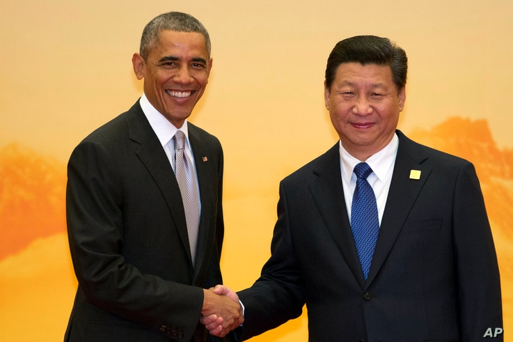 U.S. President Barack Obama, left, shakes hands with Chinese President Xi Jinping during a welcome ceremony for the Asia-Pacific Economic Cooperation (APEC) summit at the International Convention Center in Yanqi Lake, Beijing, China Tuesday, Nov. 11,...
