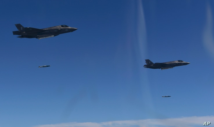 In this photo provided by South Korea Defense Ministry, U.S. Air Force F-35 stealth fighter jets drop bombs over the Korean Peninsula, South Korea, Aug. 31, 2017. The United States flew some of its most advanced warplanes in bombing drills with ally ...