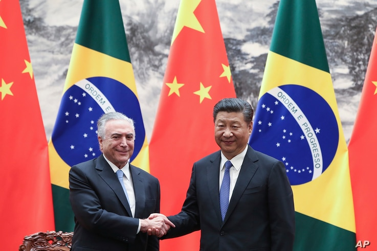 Chinese President Xi Jinping, right, shakes hands with Brazilian President Michel Temer during a signing ceremony at the Great Hall of the People in Beijing, China, Sept. 1, 2017. Temer met with Jinping on Friday ahead of next week's summit of BRICS ...