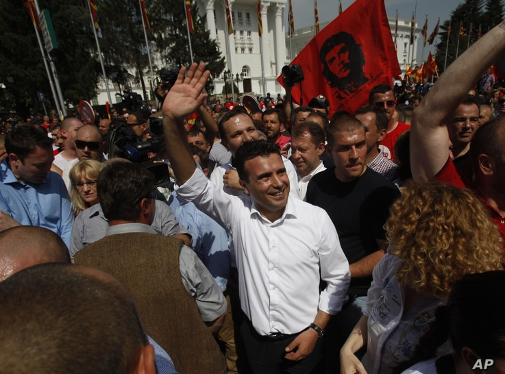 Zoran Zaev, center, the leader of the opposition social democrats, waves to the supporters during a protest in front of the Government building in Skopje, Macedonia, May 17, 2015.