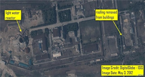 A wide area view of the Yongbyon LWR complex showing ongoing construction work on two buildings north of the reactor building.