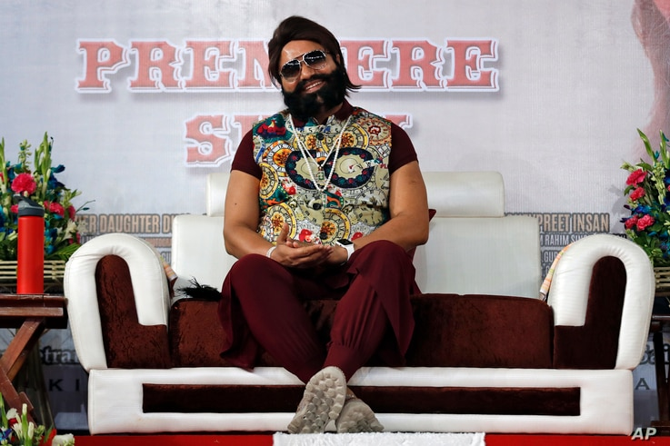 FILE - An Indian spiritual guru, who calls himself Saint Dr. Gurmeet Ram Rahim Singh Ji Insan, attends the premiere of the movie 'Jattu Engineer' in New Delhi, India, May 17, 2017.