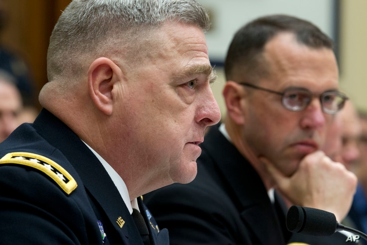 Army Chief of Staff Gen. Mark A. Milley, accompanied by Chief of Naval Operations Adm. John M. Richardson, testifies on Capitol Hill in Washington, April 5, 2017.