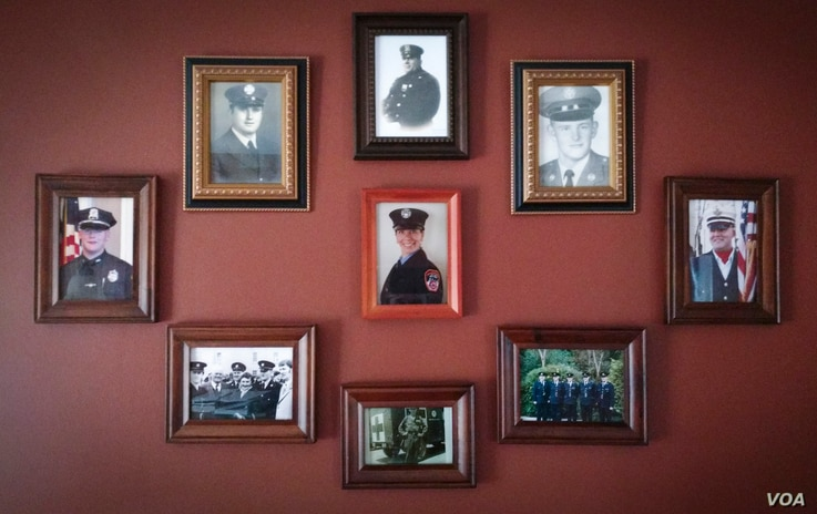 Four generations of U.S.-based soldiers, police officers and firefighters are on display inside the living room of Kieran O'Sullivan, an immigration counselor at the Irish Pastoral Centre of Boston. (Photo courtesy of Kieran O'Sullivan)