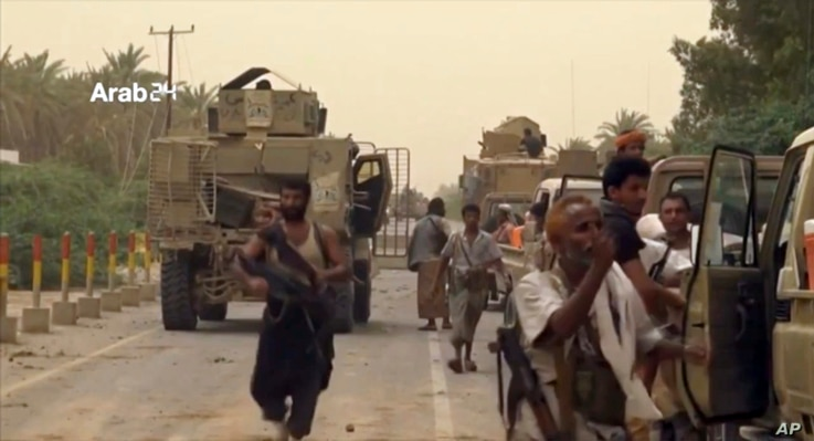A still image taken from video provided by Arab 24 shows Saudi-led forces gathering to retake the international airport of Yemen's rebel-held port city of Hodeida from the Shiite Houthi rebels, June 16, 2018.