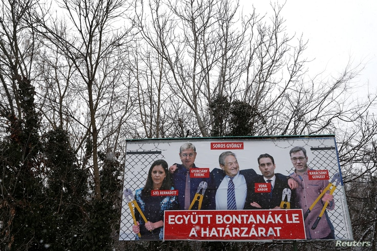 FILE - A government billboard shows George Soros (C) and opposition party leaders in Budapest, Hungary, Feb. 20, 2018. The billboard reads: 'They would dismantle the border fence together'.