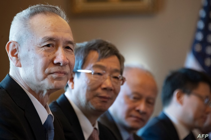 The Chinese Delegation, including Vice Premier Liu He (L) and Governor of the People's Bank of China Yi Gang (2nd L) looks on during US-China Trade Talks in Washington, DC, on January 30, 2019.