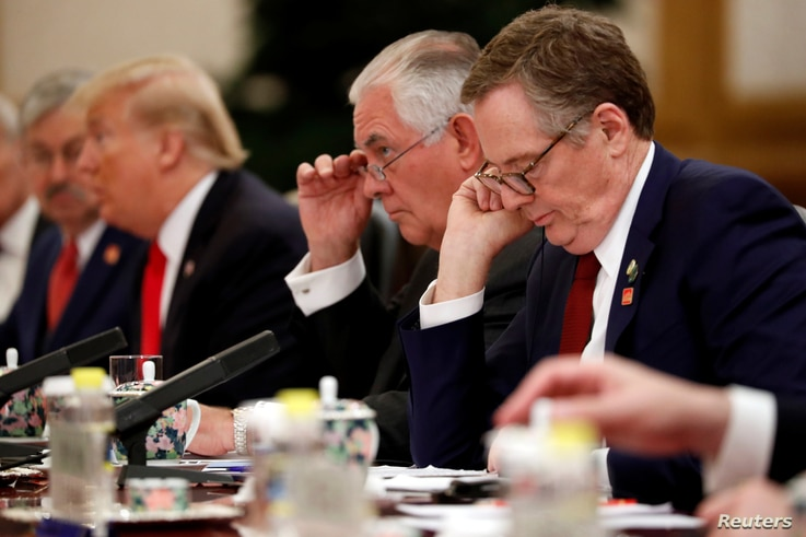 U.S. Trade Representative Robert Lighthizer (R) and U.S. Secretary of State Rex Tillerson (2nd R) attend bilateral meetings between U.S. President Donald Trump and China's President Xi Jinping at the Great Hall of the People in Beijing, China Nov. 9,...