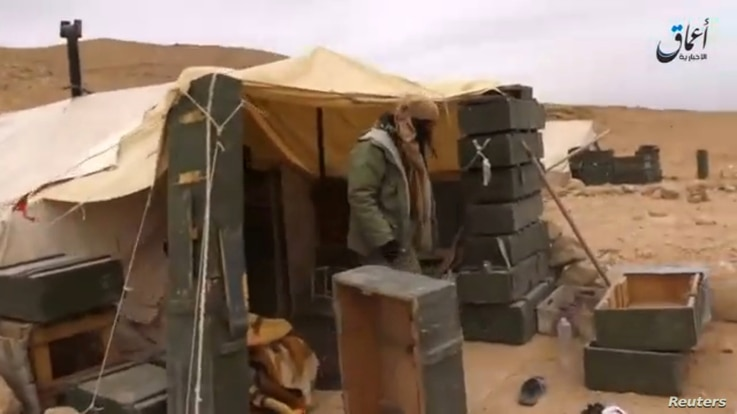 A still image taken on December 11, 2016 from a video released by Islamic State-affiliated Amaq news agency on Dec. 10, 2016, purports to show Islamic State fighters during their advance over the Hayan mountain south of Palmyra.