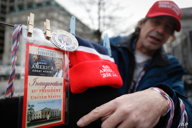 Vendors sell their President-elect Donald Trump wares in Washington, Jan. 19, 2017.