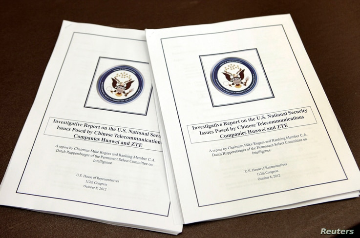 "House Intelligence Committee's report on ""national security threats posed by Chinese telecommunications companies Huawei and ZTE"" is seen at a news conference on Capitol Hill in Washington, Oct. 8, 2012."