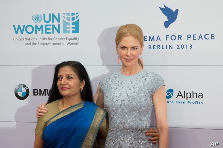 FILE - Actress Nicole Kidman, right, and the acting head of U.N. Women Lakshmi Puri attend the Cinema For Peace fundraising dinner in Berlin, Germany, July 12, 2013.