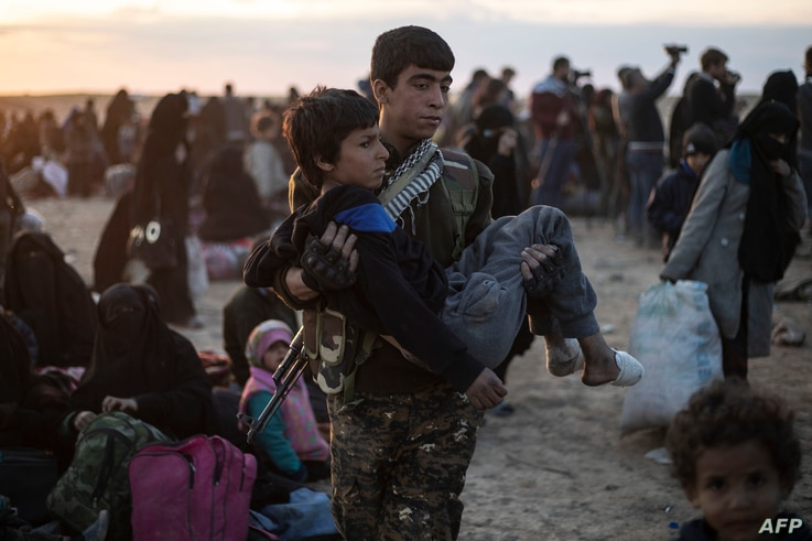 A wounded child is evacuated from the Islamic State group's embattled holdout of Baghuz and upon arriving at a screening area held by the U.S.-backed Kurdish-led Syrian Democratic Forces, in northeastern Syria, March 6, 2019.