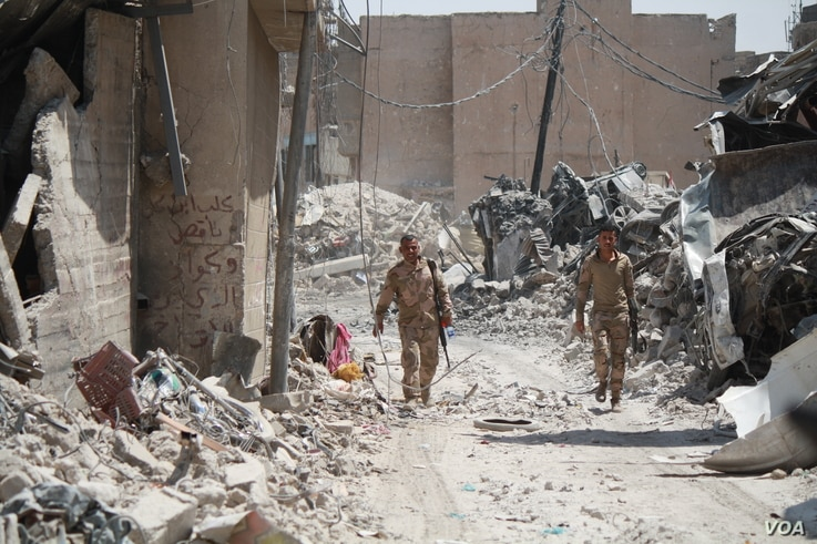 : Relatives of IS are some of the last to leave the ruins of Old Mosul.  It is unknown if they, like other civilians were forced to stay with IS or if they stayed to support fighters on July 13, 2017 in Mosul.