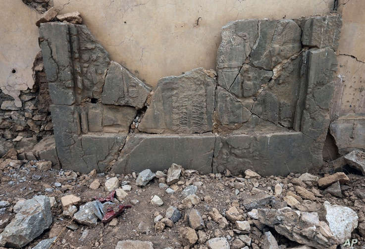 Carved stone slabs which were destroyed by Islamic State militants are seen at the ancient site of Nimrud, some 19 miles (30 kilometers) southeast of Mosul, Iraq, Nov. 16, 2016.