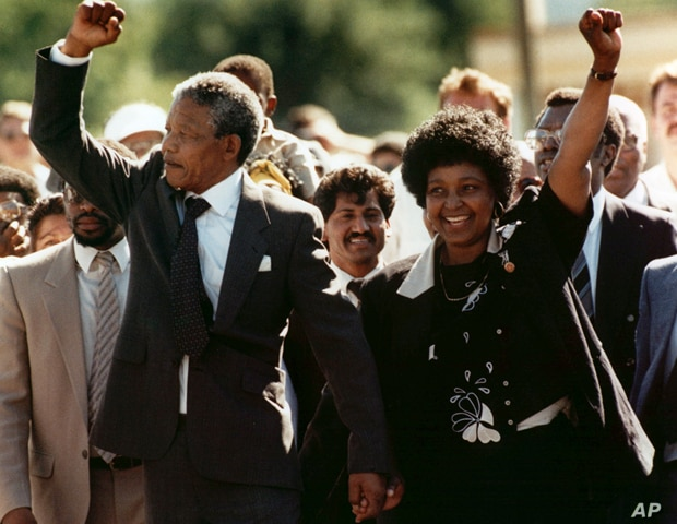 A 1990 file photo showing Nelson Mandela and his then wife Winnie walking upon his release from Victor prison, Cape Town, South Africa. (AP)