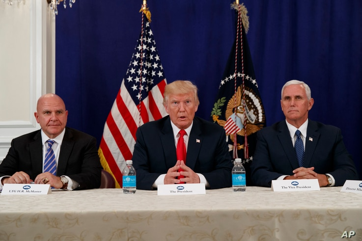 President Donald Trump, flanked by National Security Advisor H.R. McMaster, left, and Vice President Mike Pence, speaks to reporters after a security briefing at Trump National Golf Club in Bedminster, N.J., Aug. 10, 2017.