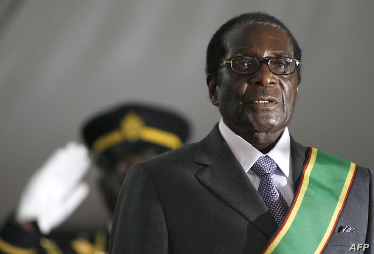 Zimbabwean President Robert Mugabe is hastily sworn in for a sixth term in office in Harare, on June 29, 2008 after being declared the winner of a one-man election. The 84-year-old veteran was boycotted by opposition leader and first-round winner Mor...