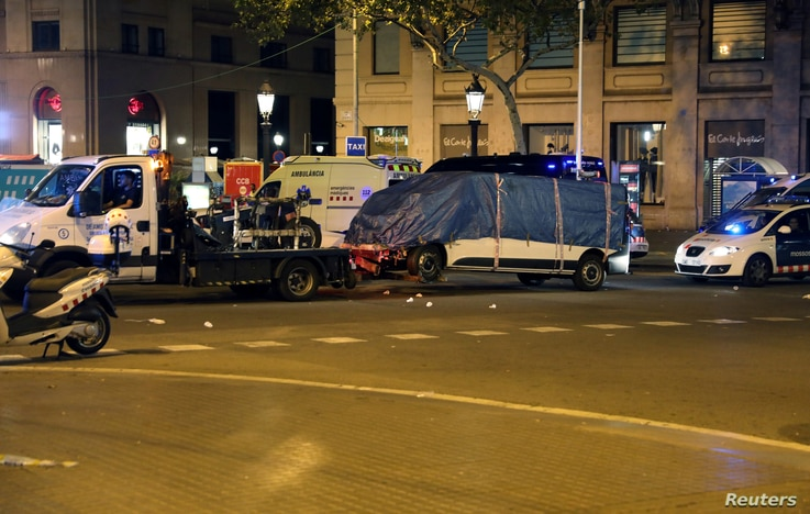 The suspected van is towed away from the area where it crashed into pedestrians at Las Ramblas in Barcelona, Spain, Aug. 18, 2017.