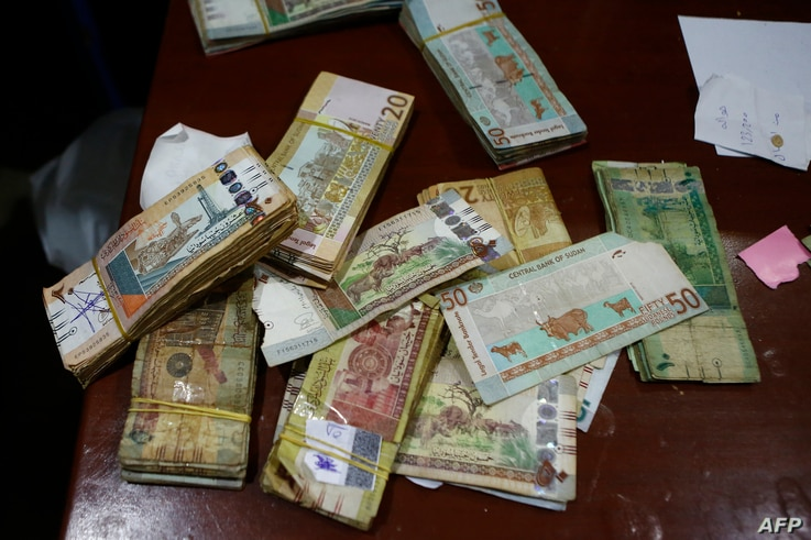 Sudanese banknotes are displayed at a foreign currency brokerage office in Khartoum on Oct. 7, 2018.