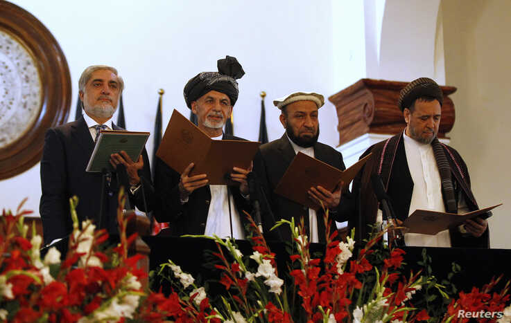 Afghanistan's new President Ashraf Ghani Ahmadzai (2nd L) stands next to Afghanistan's Chief Executive Abdullah Abdullah (L) and his deputies as he takes the oath during his inauguration as president in Kabul September 29, 2014. Afghanistan inaugurat
