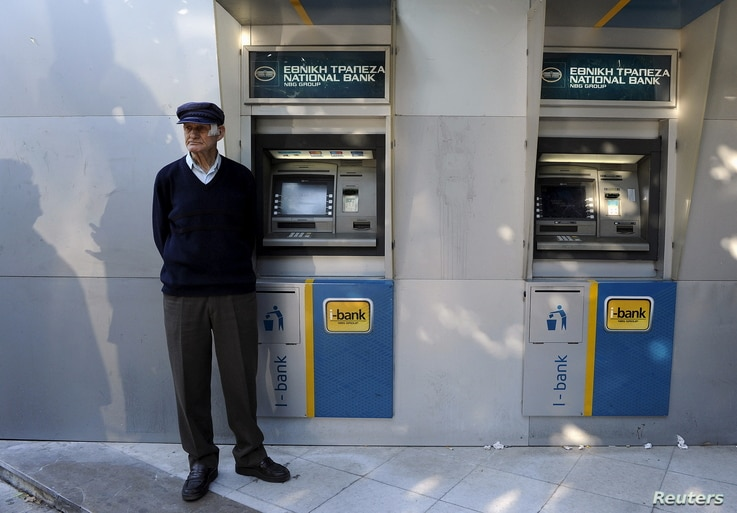 A pensioner waits outside a branch of the National Bank of Greece hoping to get his pension, in Thessaloniki, Greece, June 29, 2015.
