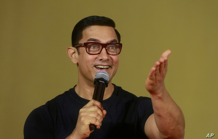 FILE - Bollywood actor Aamir Khan speaks to the media during the poster launch of his film Dangal in Mumbai, India.