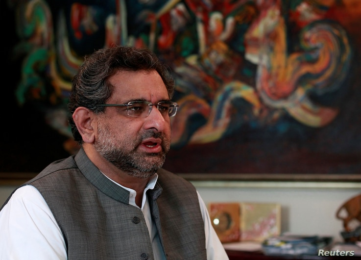 FILE - Pakistan's Petroleum and Natural Resources Shahid Khaqan Abbasi speaks during an interview at his office in Islamabad, Pakistan, Nov. 8, 2013.