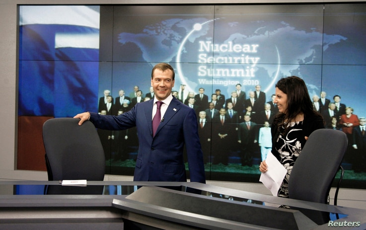 FILE - Russia's President Dmitry Medvedev (L) visits the telecomplex of Russia Today TV channel in Washington.