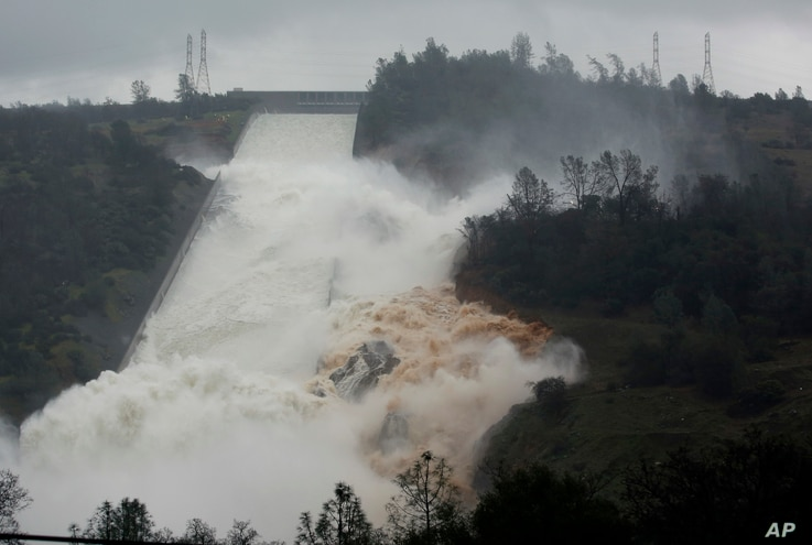 Water flows through break in the wall of the Oroville Dam spillway, in Oroville, Calif., Feb. 9, 2017. The torrent chewed up trees and soil alongside the concrete spillway before rejoining the main channel below.