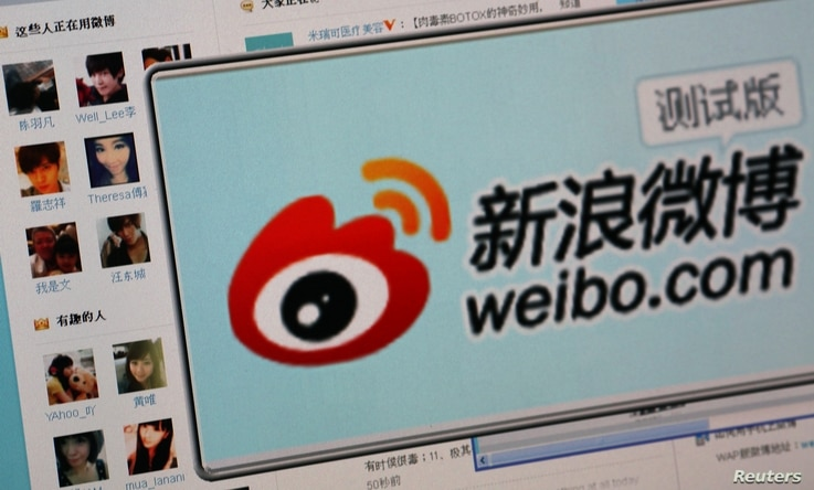 """Logo of Sina Corp's Chinese microblogging site, """"Weibo,"""" on a screen, Beijing, September 2011."""