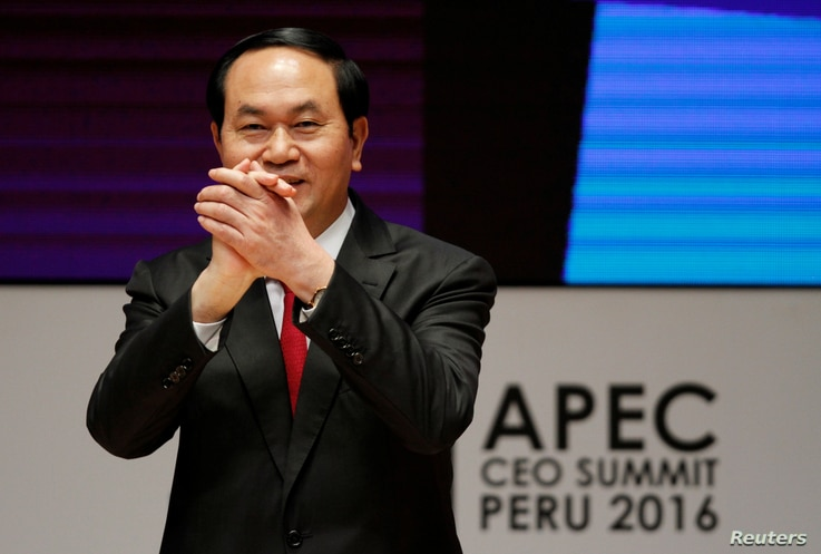 Vietnam's President Tran Dai Quang gestures during a meeting of the Asia-Pacific Economic Cooperation CEO Summit in Lima, Peru, Nov. 19, 2016.