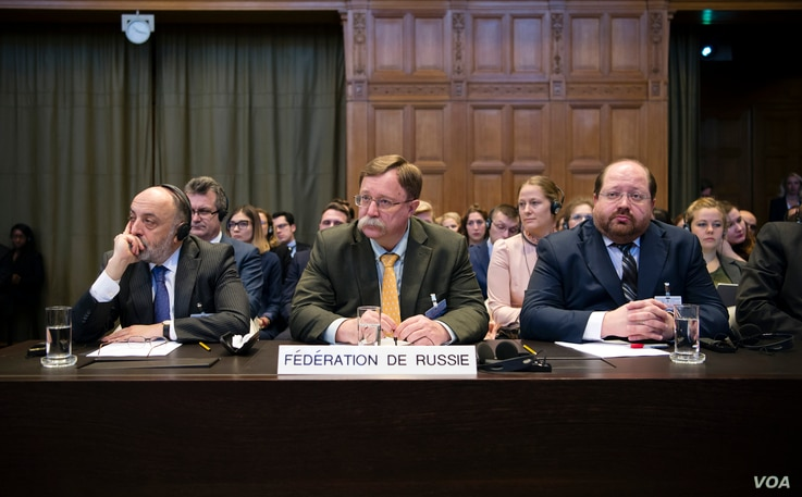 The Agents of the Russian Federation, H.E. Mr. Roman A. Kolodkin, Mr. Ilya Rogachev and Mr. Grigory Lukiyantsev, on the opening day of the hearings.