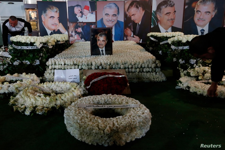 Wreaths and pictures of Lebanon's former Prime Minister Rafik al-Hariri are seen at his gravesite in downtown Beirut, Feb. 14, 2013.