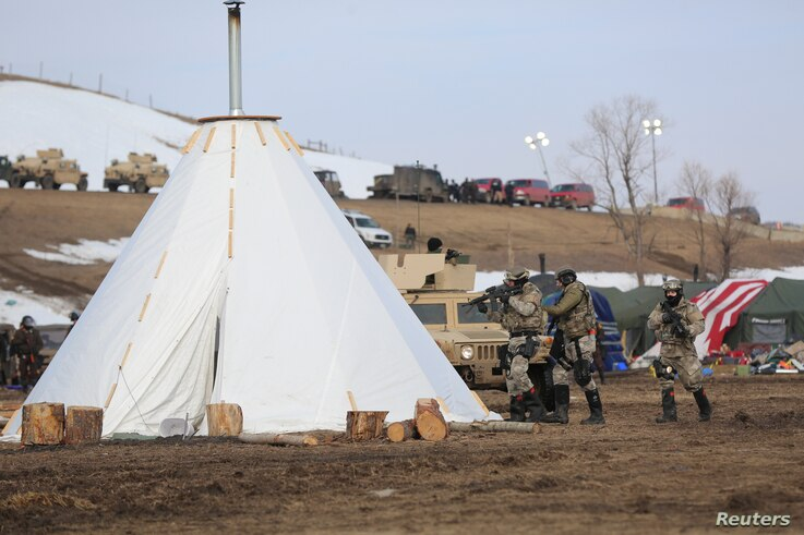 Police attempt to clear the Oceti Sakowin camp in Cannon Ball, North Dakota, U.S., February 23, 2017.