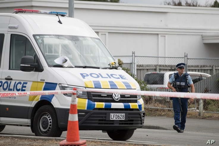 A police officer stands guard outside the Linwood mosque in Christchurch, New Zealand, March 19, 2019.