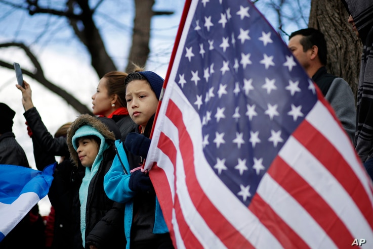 """FILE - Demonstrators are seen gathered in Baltimore, Maryland, Feb. 16, 2017, as part of a nationwide """"A Day Without Immigrants"""" protest."""