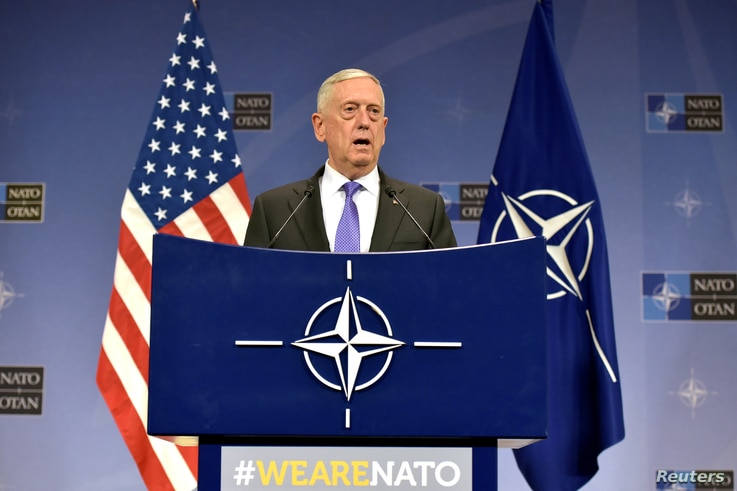 FILE - U.S. Secretary of Defense Jim Mattis gives a news conference after a NATO defense ministers meeting at the Alliance headquarters in Brussels, Belgium, June 29, 2017.