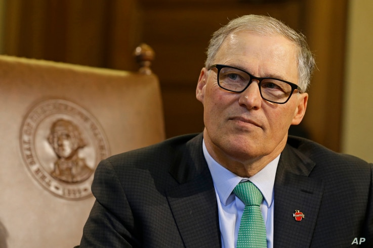 FILE - Washington state Gov. Jay Inslee talks to reporters at the Capitol in Olympia, Washington, April 19, 2017.