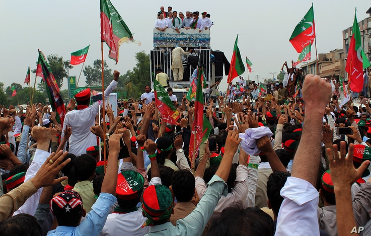 Supporters of the Pakistani Tehreek-e-Insaf party cheer their leader, Imran Khan, prior to the start of an anti-government rally in Peshawar, Pakistan, Aug. 7, 2016.