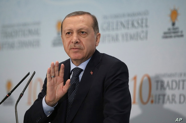 In this June 6, 2017, photo, Turkey's President Recep Tayyip Erdogan addresses foreign ambassadors at a Ramadan dinner in Ankara, Turkey. Erdogan has voiced support for Qatar in its dispute with Saudi Arabia and other nations.