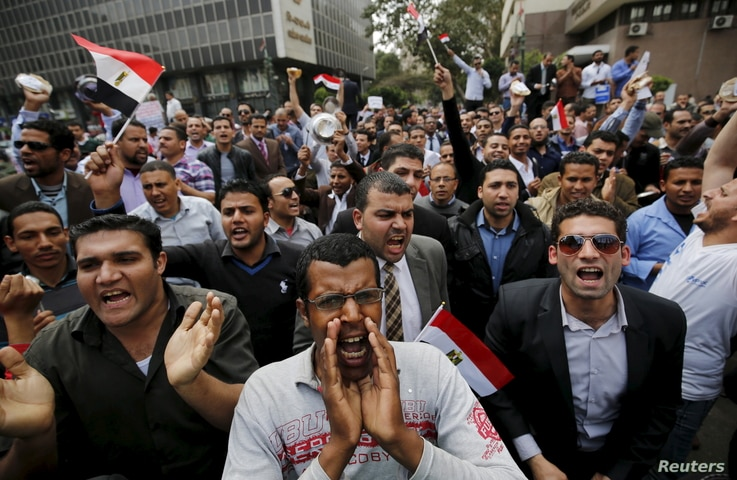 FILE - Unemployed graduates shout anti-government slogans during a protest to demand that the government offer them jobs, in front of the parliament headquarters in Cairo, March 27, 2016, where the nation's prime minister was speaking.