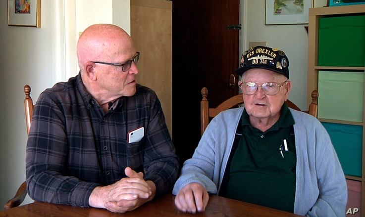 This framegrab from a video shows Gene Brick, 92, right, and his son, Bartt Brick, together in Madras, Oregon, June 12, 2017. The two, who made a telescope together in 1964, plan to watch the upcoming solar eclipse Aug. 21, 2017.