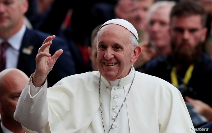 Pope Francis waves as he attends the Festival of Families at Croke Park during his visit to Dublin, Ireland, Aug. 25, 2018.