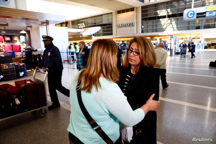 Homa Homaei, a U.S. citizen from Iran, is embraced by a lawyer working to help her Iranian family members affected by a U.S. presidential executive order on immigration, at Los Angeles International Airport in Los Angeles, Jan. 28, 2017.